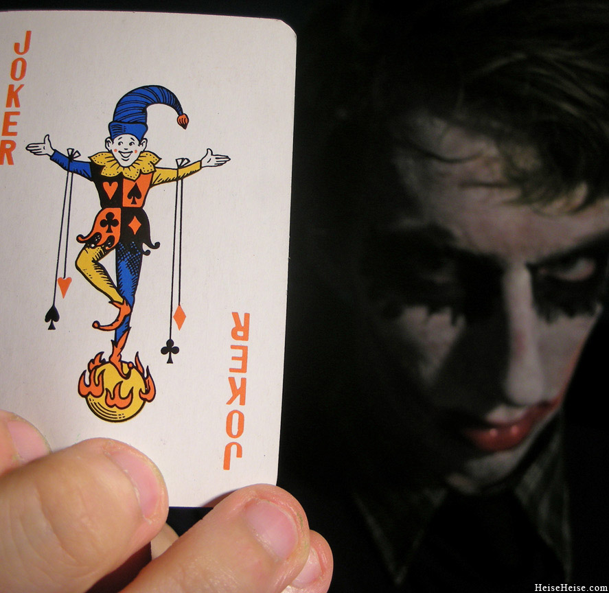 Picture of me holding a deck of card's joker