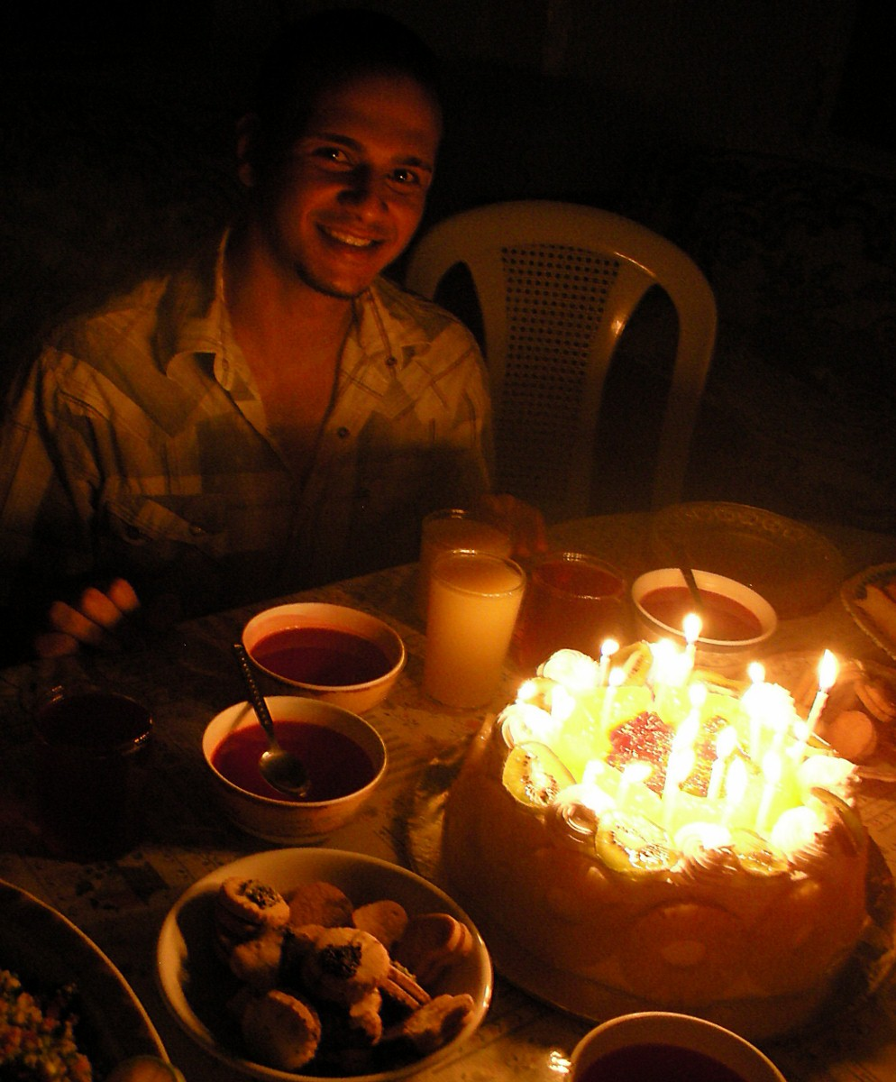 Haitham and his well-lit (and very tasty) cake.