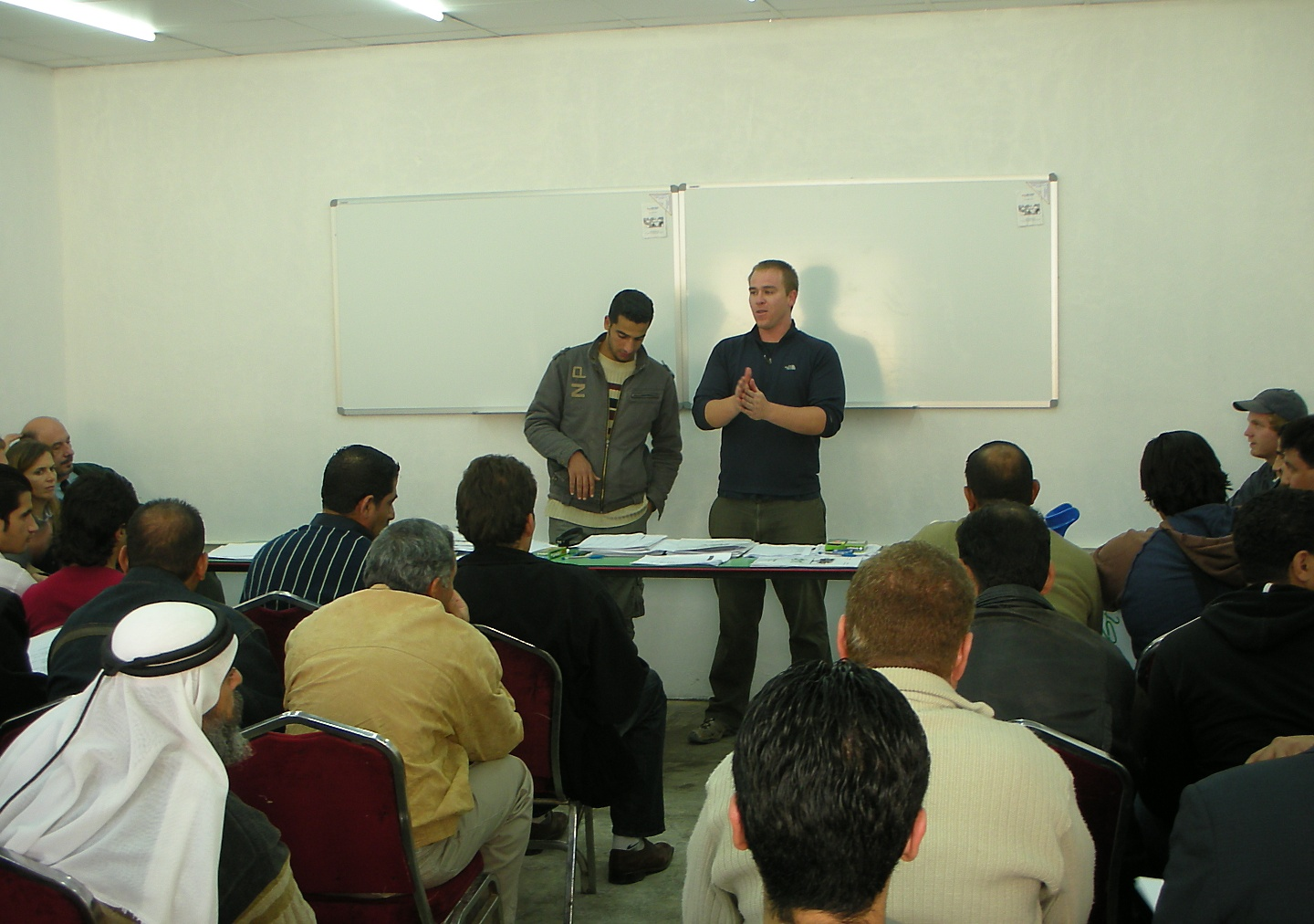 Ahmad and Aaron talk with the Iraqi refugees about the training program