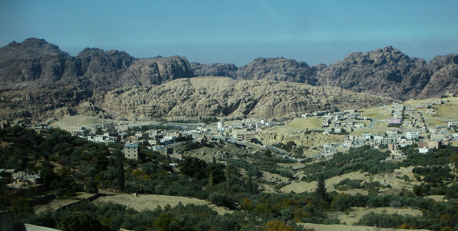 The village of Wadi Musa with the imposing Petran mountainscape beyond