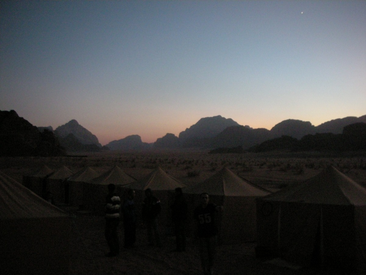 Friday evening at Wadi Rum, just as the sun vanishes behind the mountains