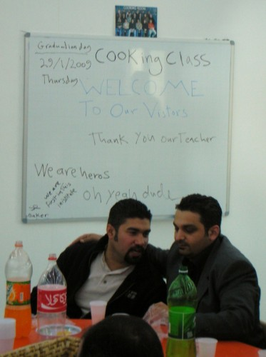 The cooking class thanks Abu Saif, their teacher