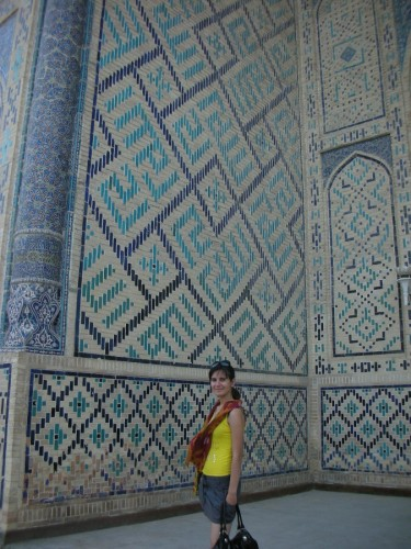 Bibi at the entrance to the Mi'hreb niche at the back of the Po-i-Kalyan mosque. Behind her, the name of God - الله - is carved into the stone