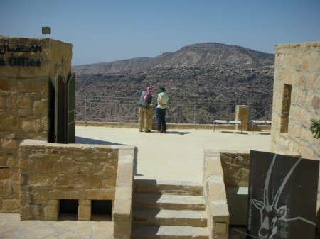 Our aged and learned guide, Abu Yehiyeh, points out some circling Griffin Eagles to mom