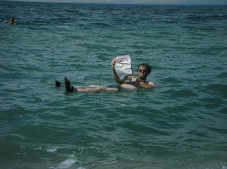 Just a regular day for dad, reading the newspaper while floating in salt water in the holy land