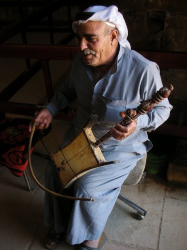 The elderly caretaker of the Umra Palace has a little merry-making of his own with the single-stringed Rababa