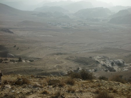 On the final (and hardest) downhill before reaching Beyda, that dim group of buildings in the middle of the plain there