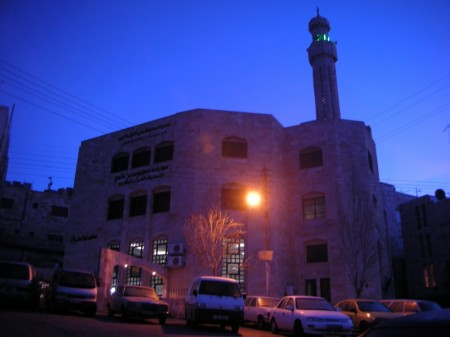 The Masjid (Mosque) minutes after completing the morning prayer. The timing is perfectly coordinating so that the sun's first light strikes the building as prayer ends