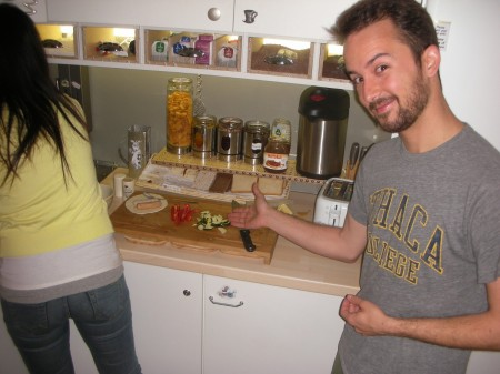 A hostel so good, even Edward Norton stays there! Jesse, a fellow American tourist, displays the breakfast spread.