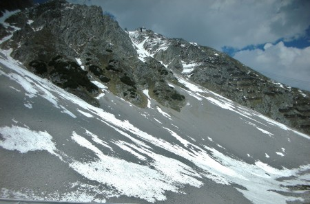 That tiny building in the picture is the final stop on Hafelkar summit. Below it are the avalanche barricades; each one is 2 meters wide. The remainder of our journey!