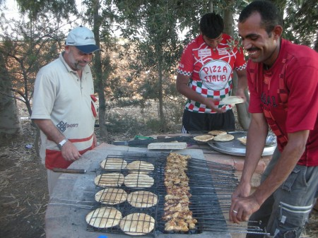 Abu Khalid and Ahmad the farm's guard grill the Ariys (flatbread with kebab meat inside) and shish tawooq (grilled and seasoned chicken chunks)