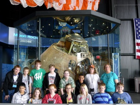 "Team Casper, posing in front of the Apollo 14 ""Casper"" command module"