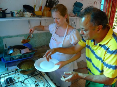 "Christine is told by Augustin to pour the mole very carefully, so it doesn't ""cross the line"" of the inner plate"