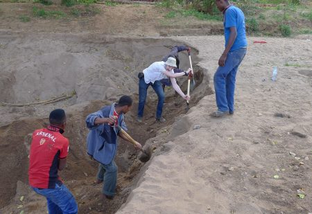 The dried-up riverbed still has water a few feet below it (for now) so I stopped to help some locals dig it out
